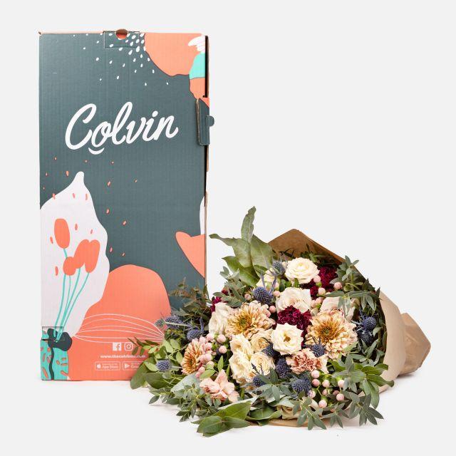 Envio a domicilio ramo con rosas y eryngium