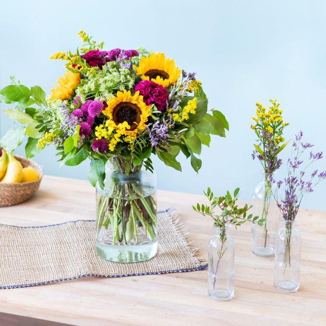 Comprar bouquet de girassóis e vasos